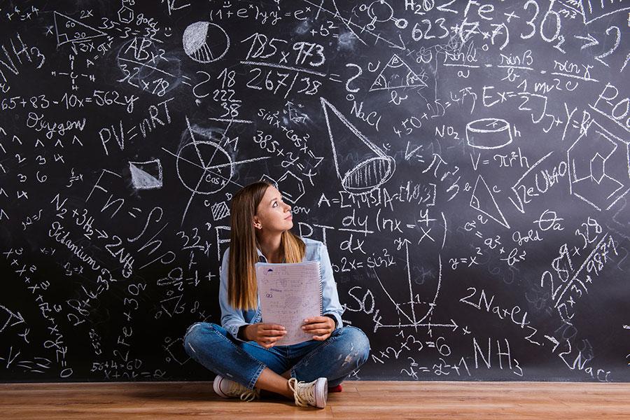 girl in front of a blackboard